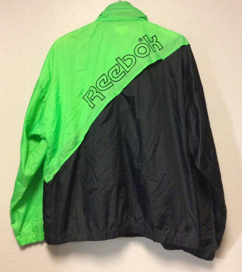 c6b06e08b0941 Vtg 90's Reebok Sport Men's Windbreaker Jacket Zip Tuck Hood Neon Lime  Green Black Large