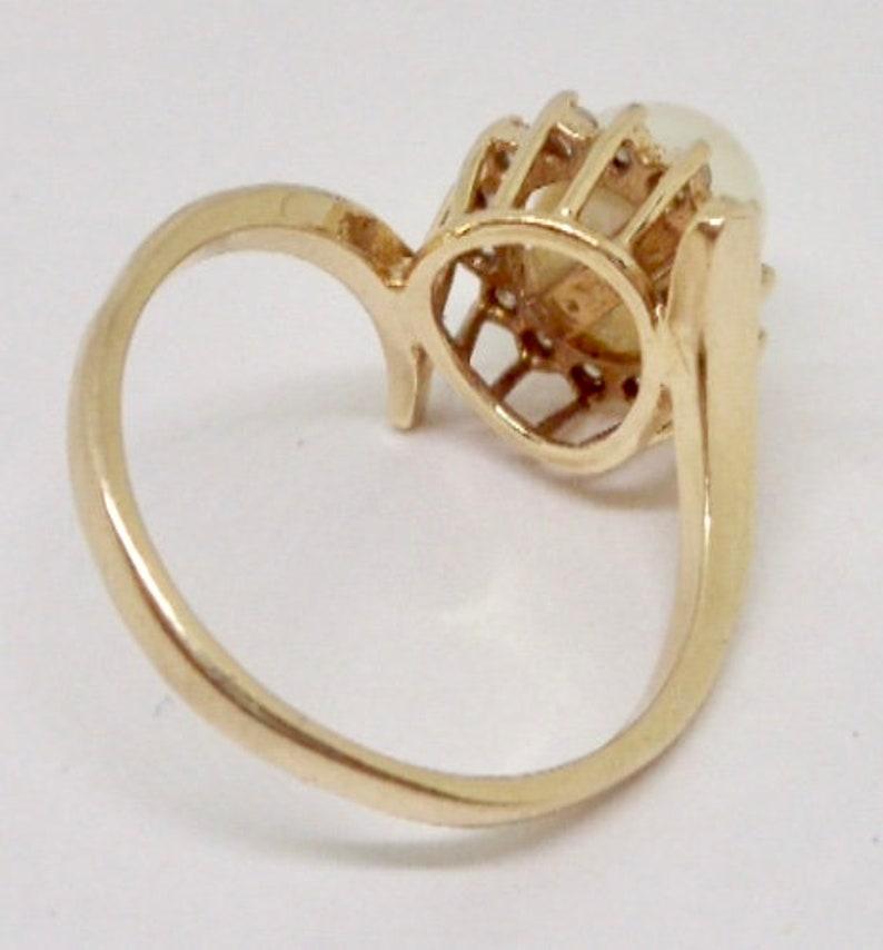Elegant 14K Yellow Gold 7mm Cultured Pearl /& Diamond Halo Ring