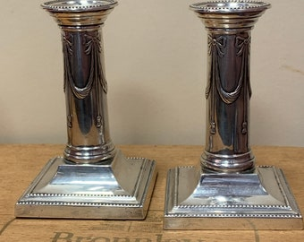 Pair of Thomas Bradbury and sons 1919 solid silver candlesticks
