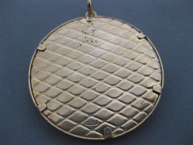 Sterling silver pendant with cloisonne enamel.