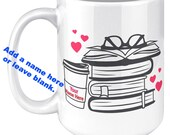 Stack Of Books With Coffee. 15oz White Mug. Enjoy Reading With Your Favorite Hot Beverage. Design On Both Sides . Useful For Pens Pencils