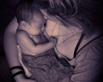 A newborn photo that I did in the studio. I just watched the mother and the baby and found a emotion