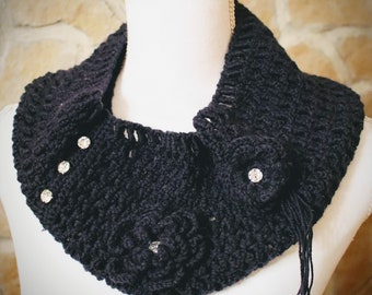 Knitted in blue wool with flowers