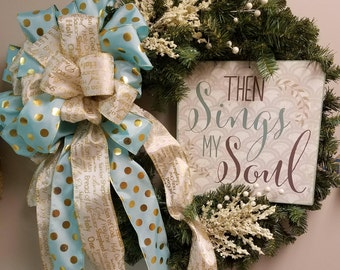 """24"""" artificial evergreen wreath with metal  religious sign.  teal and white/gold ribbon"""