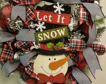 "24"" Flocked evergreen wreath with snowman sign"