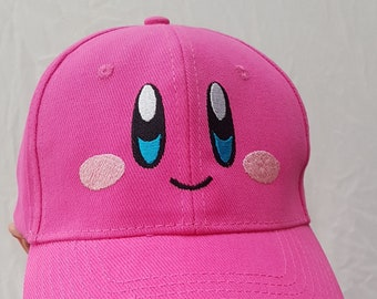 86f09f250c476 Kirby on baseball or trucker cap. The cutest face embroidered on pink color  cap. Cute