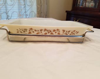Pyrex Golden Acorn 1960's casserole dish with cradle.