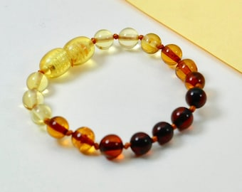 Round shape amber bracelet or anklet and stylish accessories. Perfect gift for your baby. Pure amber bracelet