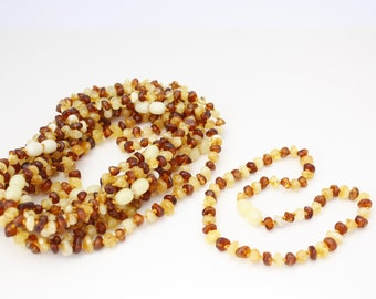 10 pieces Amber Teething baby-children necklaces 2 colours. Amber is an organic, natural product that is warm to the touch.