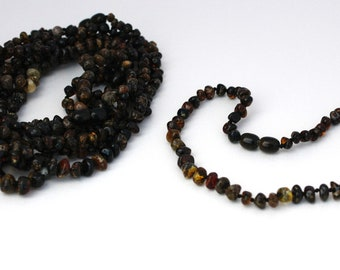 10 pieces of Baltic Amber Baby-Children necklaces made of dark green baroque style beads.