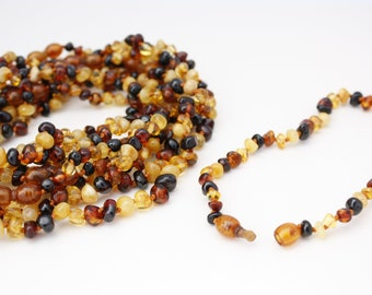 10 pieces Amber Teething Multicolour baby-children necklaces 4 colours. Amber is an organic, natural product that is warm to the touch.