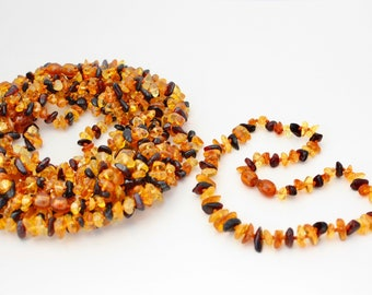 10 pieces Amber Teething Mix baby-children necklaces 3 colours. Amber is an organic, natural product that is warm to the touch.