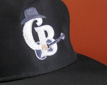 a52555bcdf1 Clint Black Guitar Man Baseball Cap With Embroidered Logo