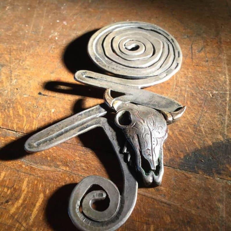 silver and brass brooch