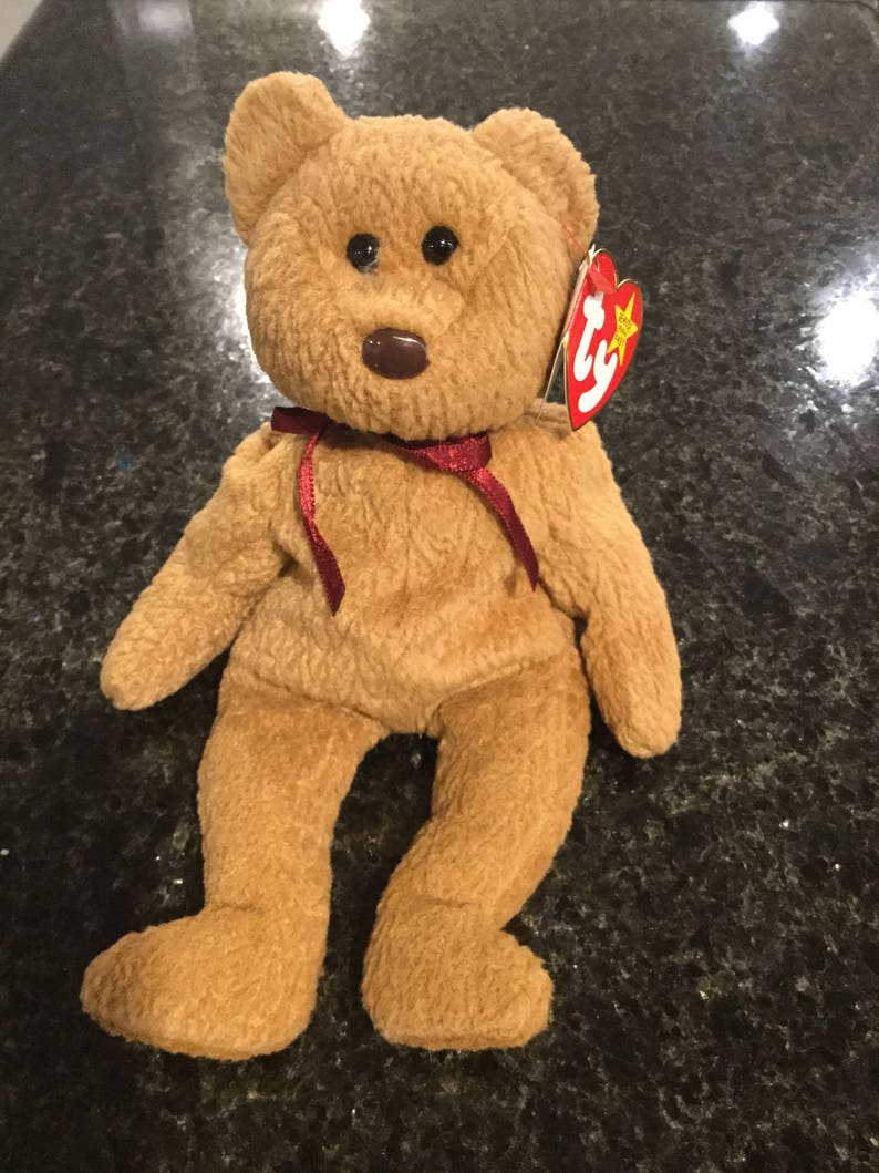 9626ea96207 Curly Retired Beanie Baby With Multiple Errors