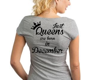Just Queens are born in December T-Shirt with text on the back.