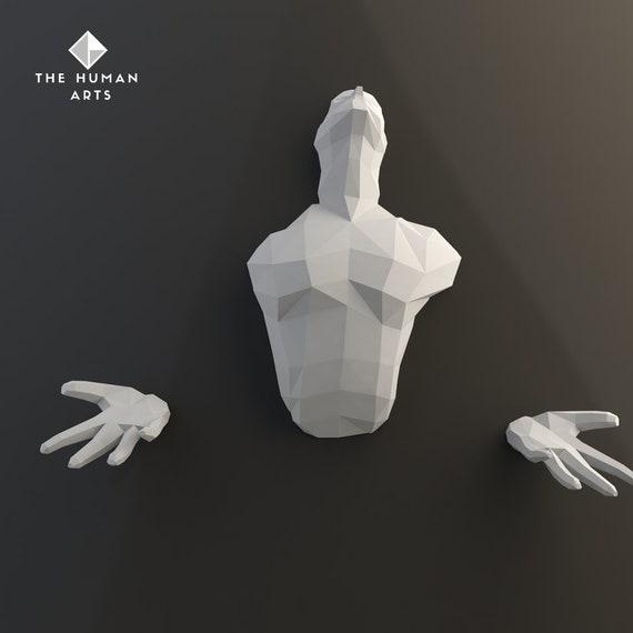 Statue en papier homme qui sort du mur