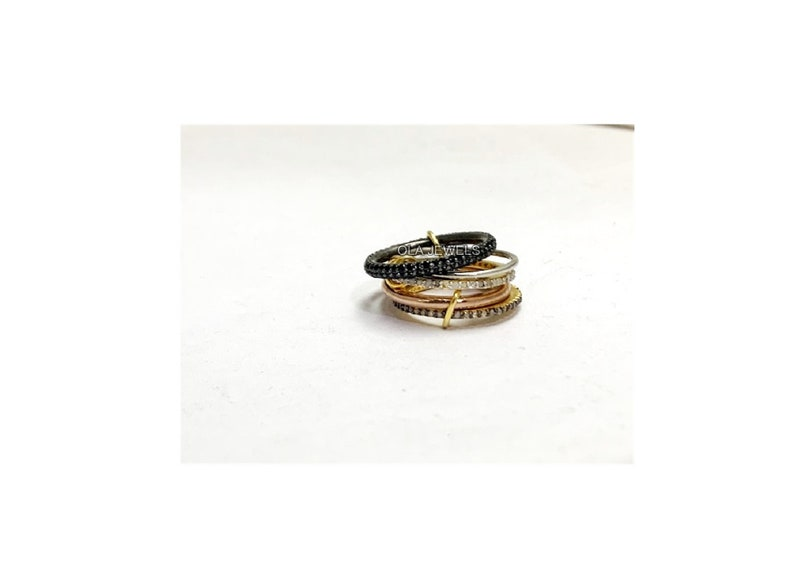Solid Sterling silver gold plated and white finish diamond and black spinel self stackable ring all size available price for 1 pcs.