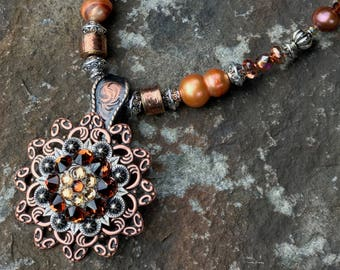 Necklace Features Antique Silver Concho With Swarovski Crystals, Freshwater Pearls, Faceted Glass and Antique Silver & Antique Copper Beads