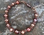 Bracelet Features Copper Freshwater Pearls, Copper-Colored Brass Beads, Antique Copper Rondelle Beads and a Magnetic Clasp