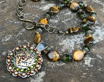 Concho Necklace Features Swarovski Crystal Rhinestones in Olivine and Topaz with Natural Tigereye Ovals and Olive Czech Cathedral Glass