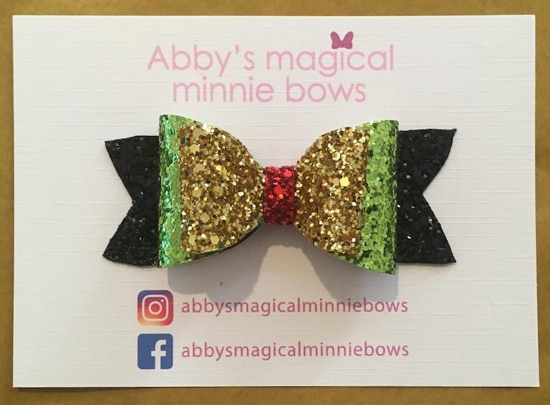Pluto inspired hair bow  Disney hair bow  handmade hair bow image 0