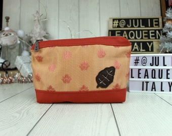 Cosmetic bag in medieval style, with embroidered lily and leaf for women.