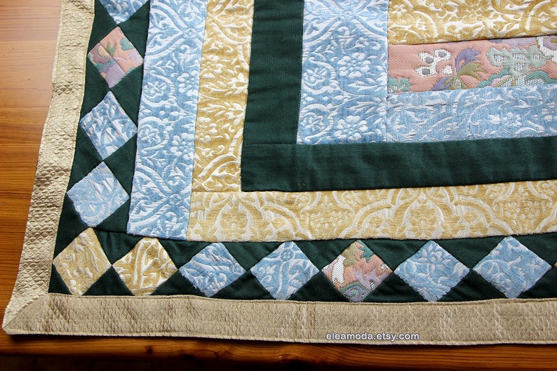 Quilted table mat in yellow and blue floral velvet for children.