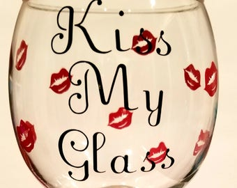 """Red Glitter Wine Glass that says """"Kiss My Glass"""" with red lips all over."""