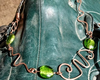 Horse hair wire wrapped copper necklace with green lamp work beads