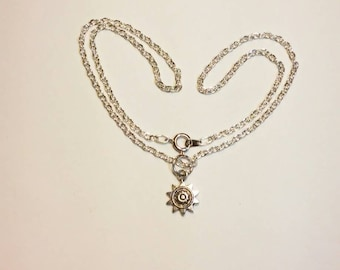 Sterling silver necklace with a star pendant.