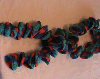 Crocheted red, green, and blue swirl scarf