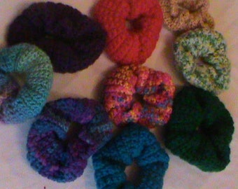Crocheted many colored hair scrunchies