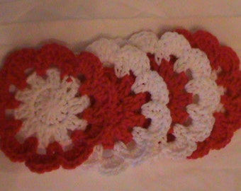 Crocheted red and white coaster set (4) with plastic bottom