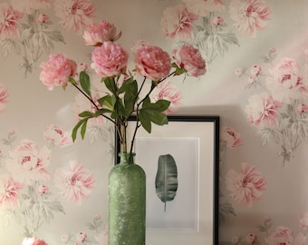 Pink peonies in a recycled glass vase arrangement