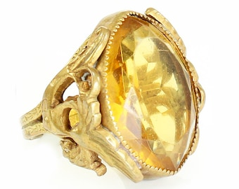 Art Deco Czechoslovakian Yellow Glass Winged Merlion Filigree Statement Ring in Gilt on Brass Size 4