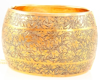 Vintage Large Embossed Botanical Hinged Bangle Bracelet in Gold Tone Circa 1940