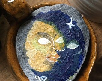 The sun and the moon, painted stone