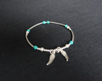 Silver and turquoise beaded memory wire bracelet with angel wing charms