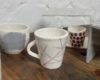 Handmade Ceramic coffee cup made and decorated by hand, white with black/grey/red lines.