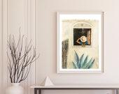 Woman holding hat on mediterranean window fine art print.