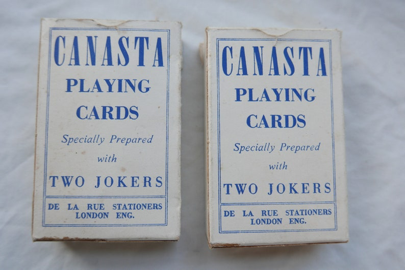 rule book and score cards Barden Canasta used once. full boxed set including plastic score card two sets of De La Rue playing cards