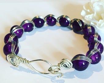 Purple wire wrapped beaded bracelet