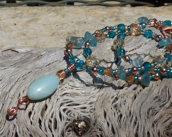 Amazonite and glass pendant on looped copper with a beaded necklace of peach, teal and champagne glass, kyanite chips and copper metal beads
