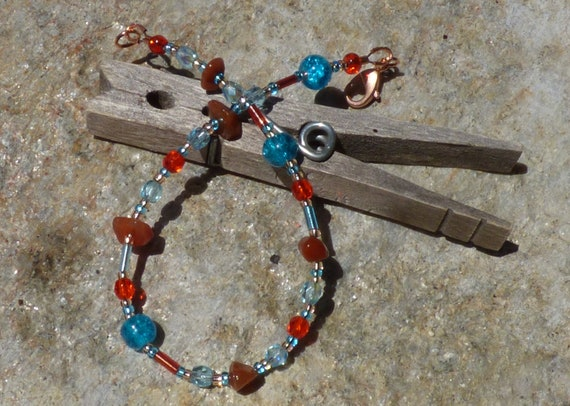 8 flexible steel wire seed bead bracelet in lemon orange and teal glass and crystal beads with a copper clasp lime
