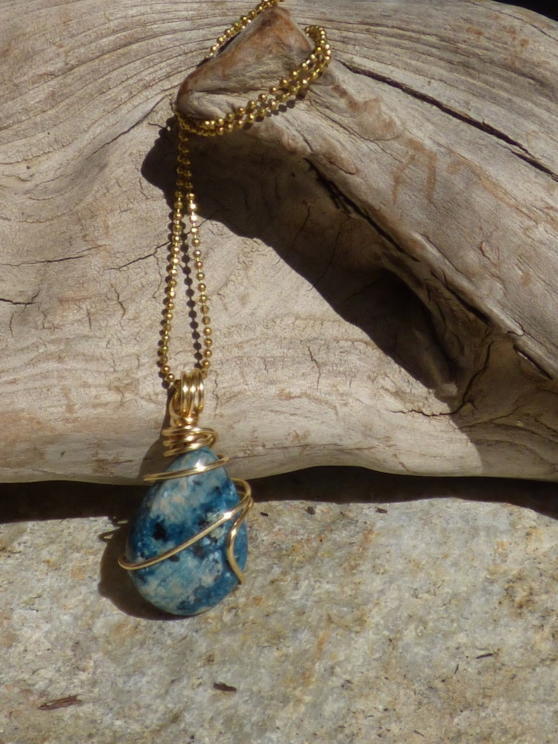 Petite sky blue cherry jasper tear drop wire wrapped pendant in raw brass with an 18 brass ball chain