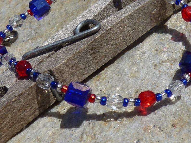 9.5 blue red and clear glass and crystal beaded ankle bracelet on flexible stranded stainless steel wire with an antique silver clasp