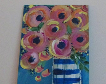 Striped vase with flowers