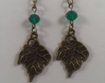 Bronze leaf earrings with teal accents.