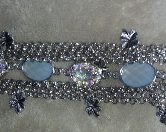 Charm Bracelet with Rhinestones and flower pendants